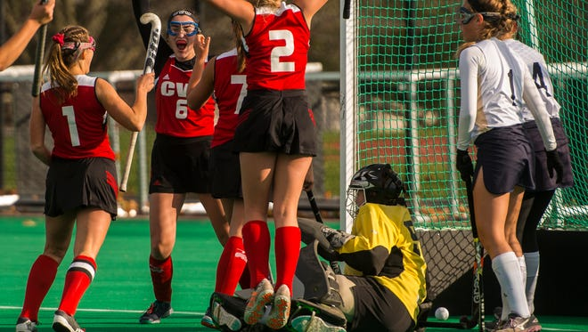 CVU celebrates what would be the game-winning goal off #7 Flynn Hall during their semi-final match against Essex at UVM on Monday, Oct. 30, 2017. CVU pulled out the win, 2-1.