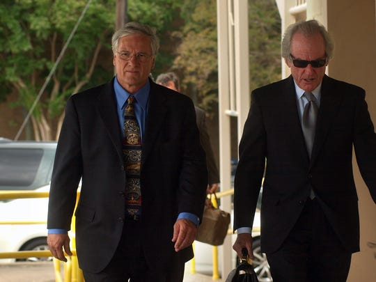 In this May 2011 Town Talk file photo, former Ball Mayor Roy Hebron (left) walks into the federal courthouse in downtown Alexandria with attorney Mike Small before his sentencing. The former Ball police officer who tipped off the FBI and later was fired recently was paid $225,000 by the town of Ball after he sued the town, Hebron and others.