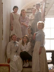 "This image released by Focus Features shows Addison Riecke, top row from left, Elle Fanning, Emma Howard and Angourie Rice, and bottom row from left, Kirsten Dunst, director Sofia Coppola, Oona Laurence and Nicole Kidman on the set of ""The Beguiled."" The film opens June 23."