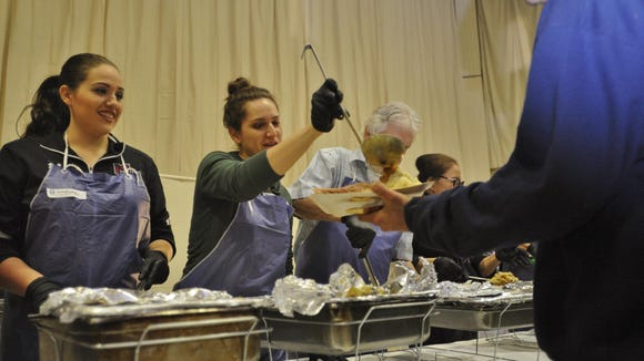 Sisters Ashley and Lindsee Gilmore volunteer every year to serve the community Thanksgiving dinner at Visalia Rescue Mission.