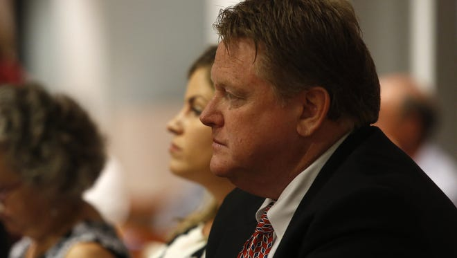 Senior Vice President at North American Properties Shawn McIntyre listens to proceedings during a July 19 CRA meeting at City Hall.