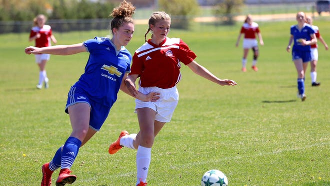 Montana Rush's Anslee Klinefelter, left, competes in the U15/16 division last summer during a tournament at Siebel Soccer Complex.