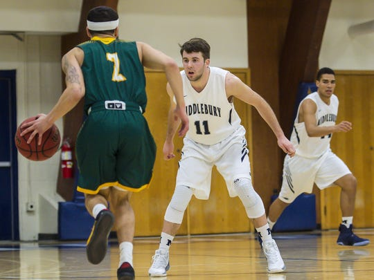 Middlebury's Matt St. Amour, right, defends against Lyndon State's Eric Vargas in Middlebury on Tuesday, January 24, 2017.