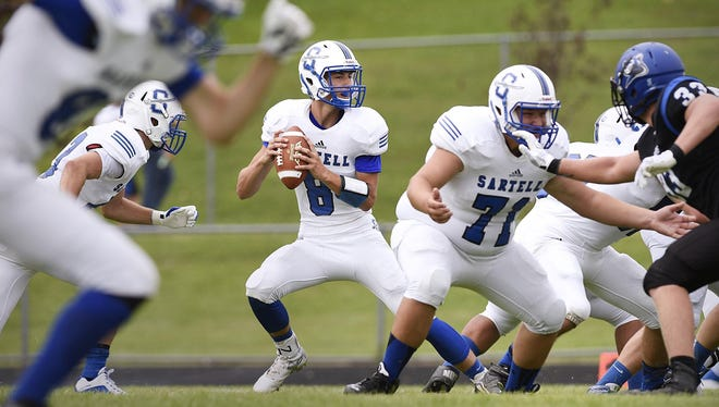 Sartell quarterback Christopher Beling looks for an open receiver Saturday against Rogers during the first half in Rogers.