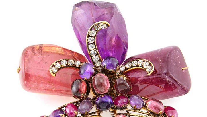 Among items being auctioned from the Jessye Norman White Gates Collection is a gilt-metal, amethyst, quartz, glass and rhinestone pin by Iradj Moini.