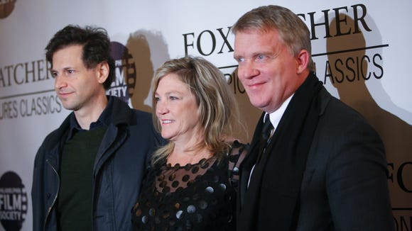 """Foxcatcher"" director Bennett Miller (left), actor Anthony Michael Hall (right) and Nancy Schultz, widow of Olympic champion David Schultz, attend the film's red-carpet premiere in Philadelphia."
