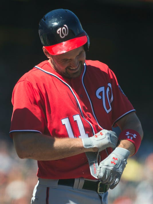 Washington Nationals' Ryan Zimmerman (11) reacts after being hit by a pitch from San Francisco Giants relief pitcher Santiago Casilla (46) during the ninth inning of a baseball game on Sunday, July 31, 2016, in San Francisco. (AP Photo/D. Ross Cameron)
