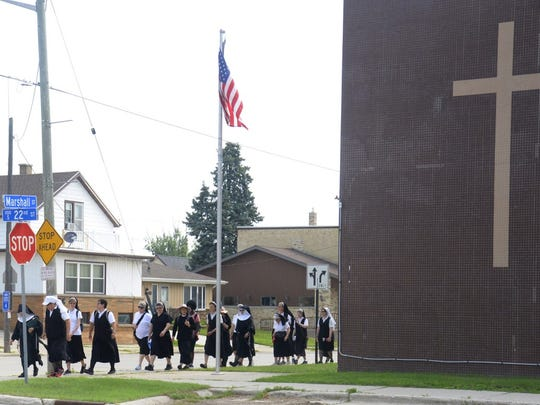 Pilgrims leaving the second historic heritage site: St. Mary's school.