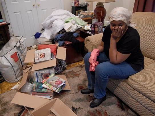 Yolanda Lake sits in the living room of the home on