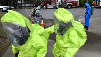 West Wilson Utility employees walk back to the staging area after being decontaminated by members of WEMA during a HazMat training exercise that simulated a chlorine leak at West Wilson Utility's water treatment plant on Beth DrFriday March 24, 2017, in Mt. Juliet, TN