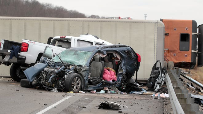 Police said the driver of this tractor-trailer was northbound on I-71 and clipped a disabled vehicle in the high-speed lane.  The truck then crossed the median and struck two vehicles head-on.  The driver of this pickup truck was killed, while the driver of the other car was hospitalized with life-threatening injuries.