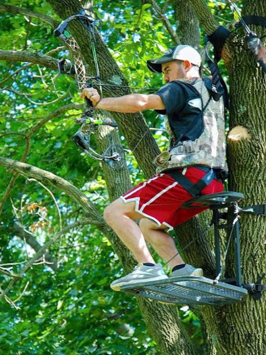 Archers planning to bowhunt from a tree stand should practice shooting from one prior to bow season.