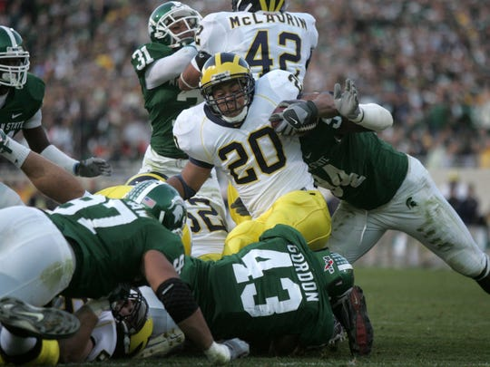 Michigan running back Mike Hart (20) fights for extra yardage in the third  quarter of the Michigan and MSU football game on Saturday, Nov. 3, 2007 at Spartan Stadium in East Lansing.