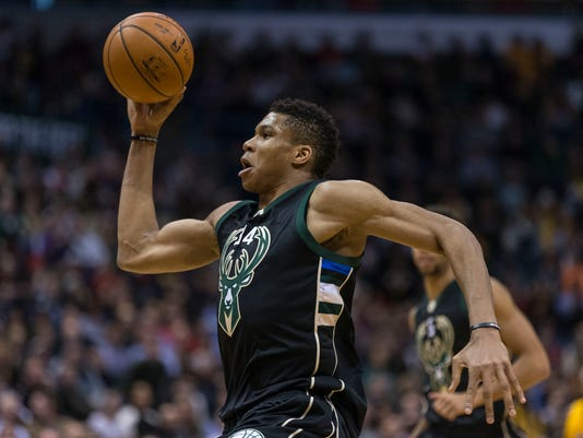 Milwaukee Bucks' Giannis Antetokounmpo flies in for a dunk agains the Los Angeles Lakers during the second half of an NBA basketball game Monday, Feb. 22, 2016, in Milwaukee. (AP Photo/Tom Lynn)