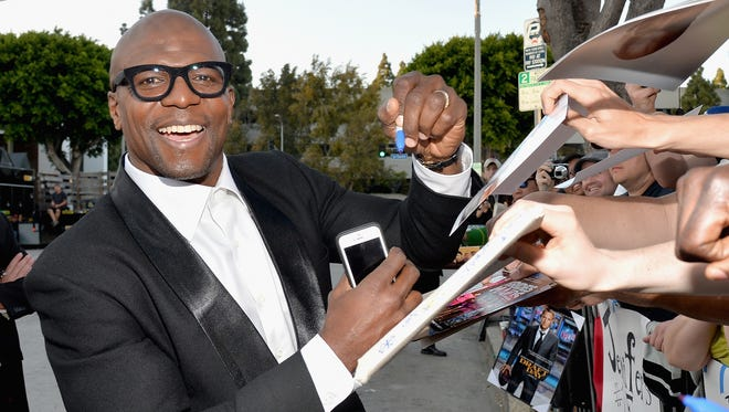 "Terry Crews attends Premiere Of Summit Entertainment's ""Draft Day"" at Regency Bruin Theatre on April 7, 2014 in Los Angeles, California."