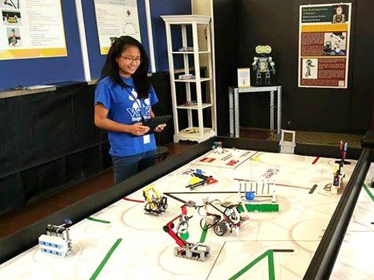 The Lego robotics display is a hand-on exhibit focused on STEM literacy.