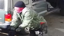Video surveillance photos released by the Detroit police show two masked men running with guns in their hands during the robbery at approximately 11 am at the store, located on the 12100 block of Coyle on Detroit's west side.