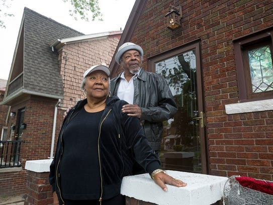 Janice Wells, left, poses with her husband Larry Wells,