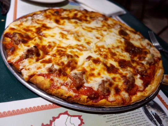 Salerno's Chicago-style pizza is smothered with cheese