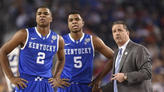 Kentucky coach John Calipari talks to guards Andrew Harrison (5) and Aaron Harrison (2) during the Final Four game against Wisconsin.