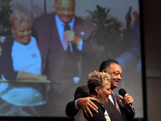 "Civil Rights leader founder and president of the Rainbow PUSH Coalition Rev. Jesse Jackson (right) embraces Pastor Gina Stewart  during an appearance at Christ Missionary Baptist Church on South Parkway Sunday. ""Our challenge today is not just to admire Dr. King, but to follow him,"" Jackson said as he made several stops at local churches during his visit to celebrate Black History Month."
