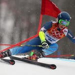 United States' Mikaela Shiffrin passes a gate in the first run of the women's giant slalom at the Sochi 2014 Winter Olympics, Tuesday, Feb. 18, 2014, in Krasnaya Polyana, Russia.