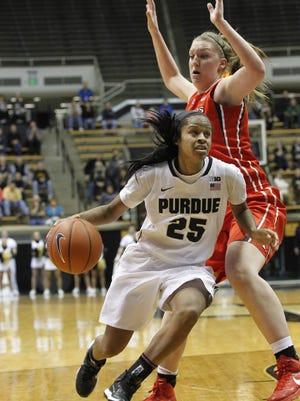 April Wilson drives beneath Christa Evans of Rutgers Thursday, January 29, 2015, at Mackey Arena. Rutgers beat Purdue 58-49.