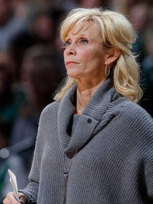 Michigan State women's basketball coach Suzy Merchant watches the action against Nebraska Saturday in East Lansing. Merchant returned to the bench against the Huskers after fainting a week earlier during MSU's game against Illinois.