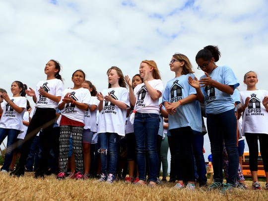 Students from W.C. Andrews Elementary School sing their school anthem during the groundbreaking ceremony Tuesday, May 16, 2017, in Portland.