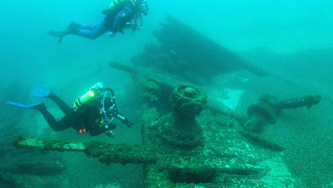 Divers survey the S.C. Baldwin shipwreck, 60 to 80 feet below the Lake Michigan surface nearest to Point Beach State Forest.