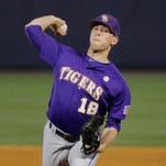 LSU pitcher Austin Bain delivers against Arkansas during the first inning of the Tigers' Southeastern Conference tournament game Thursday.