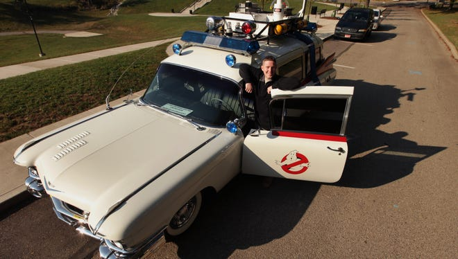 """Loren Baldwin of Loveland, Ohio, with his replica of the Ecto-1 from the film """"Ghostbusters."""""""