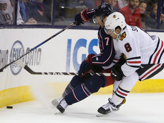 Columbus Blue Jackets' Jack Johnson, left, and Chicago Blackhawks' Nick Schmaltz chase the puck during the first period of an NHL hockey game Saturday, Feb. 24, 2018, in Columbus, Ohio. (AP Photo/Jay LaPrete)