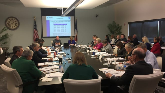The Iowa Public Employees' Retirement System's Investment Board is shown at a meeting held on Dec. 1, 2016, to hear an actuarial report on the system's pension fund.