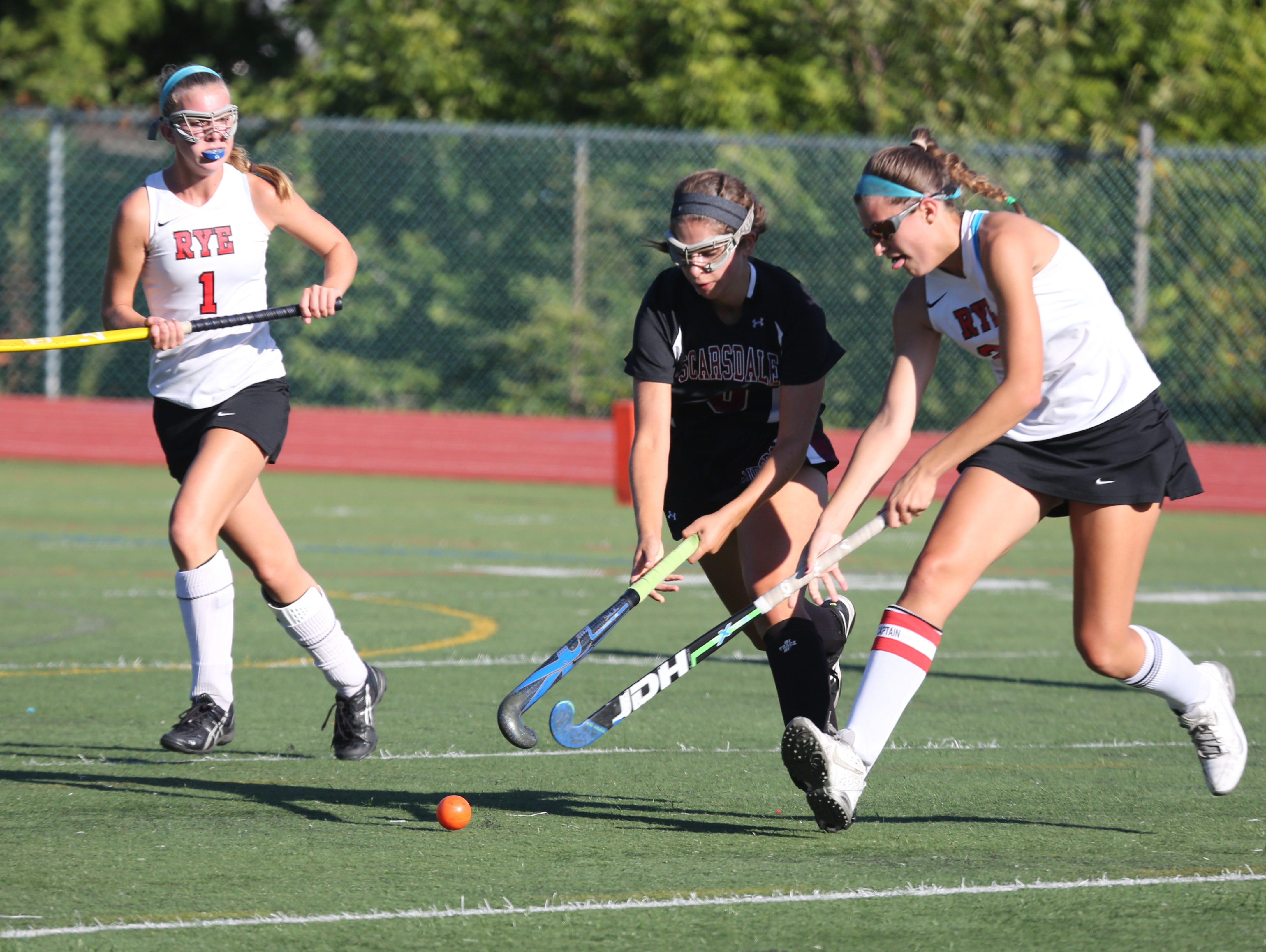 Scarsdale's Ali Bauersfeld and Rye's Ally Abate chase down a ball during their field hockey game in Rye, Sept. 24, 2015. Rye beat Scarsdale, 3-1.