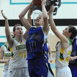 Smith Valley's Kellie Rogaczewski shoots with Heather Lacovara, left and Angela Porter covering her in the Division IV regional tournament at North Valleys on Friday.