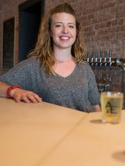 Andrea Homoya, co-owner, at Ash & Elm, a new cider shop in the 2100 block of East Washington Street, Indianapolis, Wednesday, June 22, 2016.