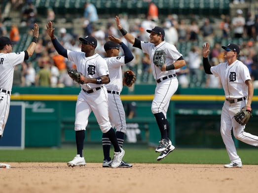 The Detroit Tigers celebrate their 6-1 win over the