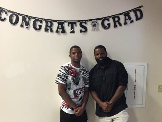 Xavier Simpson with his dad, Quincey Simpson.