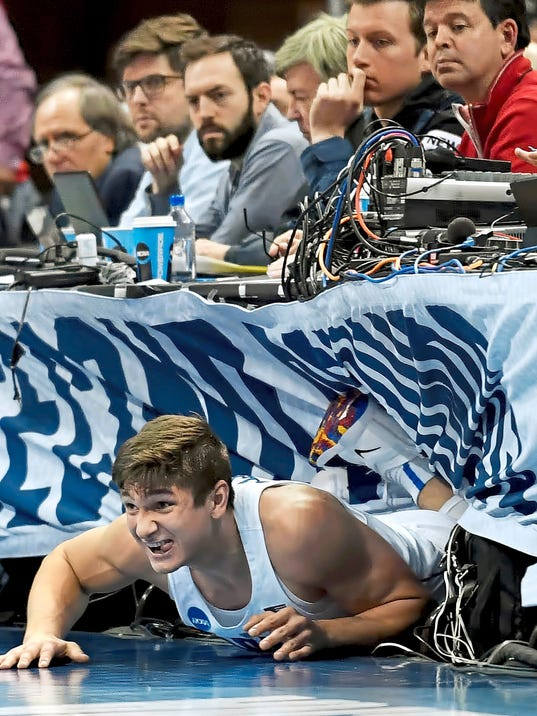Duke's Grayson Allen ends up under the media row after diving for a loose ball against Rhode Island in the first half of the second round of the NCAA tournament Saturday, March 17, 2018, in Pittsburgh, Pa. (Matt Freed/Post-Gazette via AP)