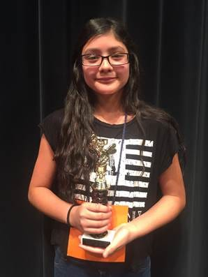 Zara Dalton-Torres, a sixth-grader from Bayard Elementary, won the Cobre District Spanish Spelling Bee on Tuesday.