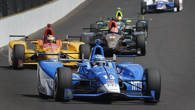 Chip Ganassi Racing IndyCar driver Tony Kanaan (10) leads a pack of cars as they drive into turn one during their  on Carb Day Friday, May 26, 2017, at the Indianapolis Motor Speedway