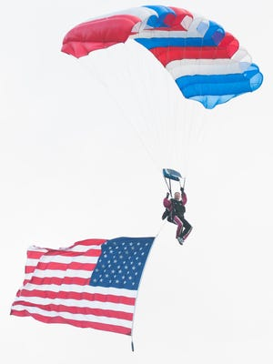 """Parachutists with Flags from different branches of the military along with the American Flag, parachuted into the """"Freedom isn't Free"""" event on Sunday, November 3, 2013 , at the Fairfield County Fairgrounds"""