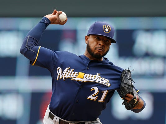 FILE - This April 19, 2016 file photo shows Milwaukee Brewers relief pitcher Jeremy Jeffress throwing against the Minnesota Twins in the ninth inning of a baseball game in Minneapolis. The AL West-leading Texas Rangers have acquired two-time All-Star catcher Jonathan Lucroy and closer Jeremy Jeffress from the Milwaukee Brewers in a trade for two former first-round picks, Monday, Aug. 1, 2016. (AP Photo/Jim Mone, file)