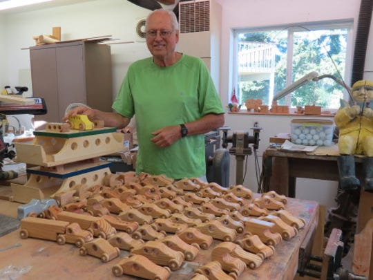 Poulsbo's Roger Serwold shows off some of his wood shop creations.