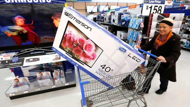 Shopper Kathleen Bray of West Des Moines found a deal on a 40-inch television well before Black Friday while shopping Tuesday at the Windsor Heights Wal-Mart.