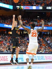 Maryland Terrapins guard Kevin Huerter (4) shoots the