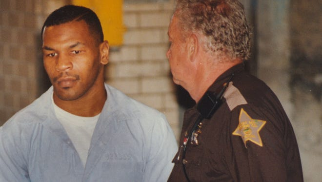 Mike Tyson is taken to court June 13, 1994 for his request for early release from prison. The request was denied.   Mike Fender/The News