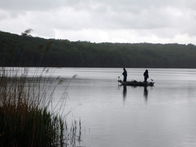Fisherman stand with lines in West Milford's Echo Lake