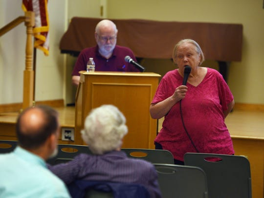 Margaret Kaiser, president of the Genealogical Society of Bergen County, speaks to participants as Fred Voss, the organization's education chair, prepares for a slide show at the begining of a monthly meeting of the society at Ridgewood Library on July 24.